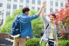 View top-quality stock photos of Cheerful College Boys High Fiving. Find premium, high-resolution stock photography at Getty Images. Student Photo, College Boys, Drawing Base, Beijing China, High Five, Happy Life, Royalty Free Images, Cheer, Law