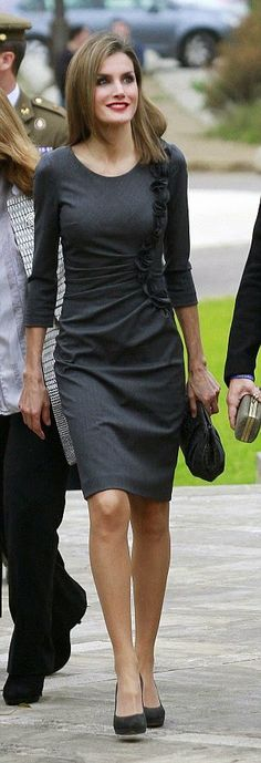 Queen Letizia was business like in a tailored grey dress for the event in the Mallorcan capital, Palma