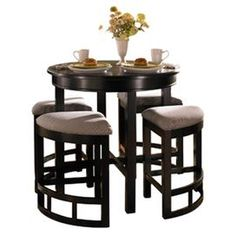 Wood counter table in black.    Product: Counter table    Construction Material: Wood   Color: Black           Dimensions: 35 H x 36 Diameter  Note: Stools not included