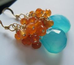 Aqua and orange earrings.