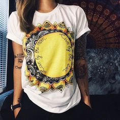 I don't know why exactly but I love this tee. Maybe because it kind of looks like my favorite flower (sunflowers) and I can totally picture rockin' it with some comfy jeans and sneaks!