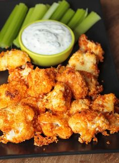 Buffalo Cauliflower Bites w/ Cheater Vegan Ranch - So easy to make! They make great party appetizers and snacks. #vegan #cauliflower #appetizer #partyfood #gameday #spicy #buffalosauce #dairyfree #superbowl #gameday