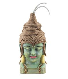 Shiva is one of the main deities of Hinduism.This terracotta Shiva head is beautifully handcrafted to give a tranquil tone to your interiors. Its head is crafted from coir which adds to its beauty. The two coir pieces on its head which are painted white depict the ganges which flow from lord Shiva's head to the valley below.