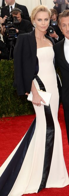 Who made  Charlize Theron's white strapless gown and jewelry that she wore to the 2014 Met Gala?