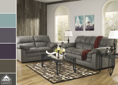 The blend of turquoise and deep purple work so perfectly with a gray sofa