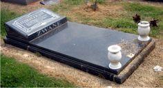 """A rustenburg grey granite """"flat"""" style memorial."""