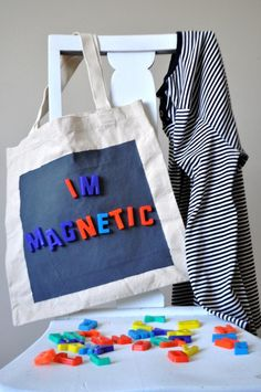 Ducklings In A Row - Hair + DIY Tutorials: I'm Inexplicably Drawn to You...DIY Magnetic Tote Bag ~ What a brilliant idea for a dollar store canvas tote and magnets! The most expensive thing about this is the magnetic paint. Be sure to have it mixed at the store!!!!