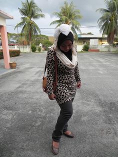 taken in 2010 (leopard print top, skinny jeans, esarli ballet sandal)