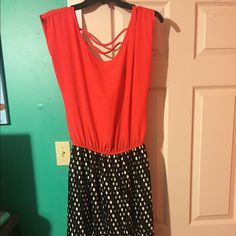 Red and black dress with polka dots Red and black dress with a pleated bottom. Has two straps on the back at the top. I got several compliments when wearing this. Only worn a couple times Dresses