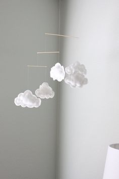 This mobile has 5 WHITE clouds (not cream like the last 2 pictures), each approximately 15-17 cm long and 10-12 cm high at the highest point. Sizes
