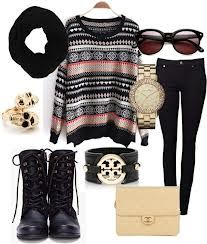 Long sleeve knit, scarf, skinnys, and boots.