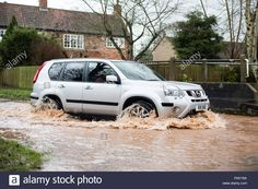 March becks in the villages of Oxton ,and Gonalston have burst their banks in places . Water lane in Oxton was flooded earlier Environment Agency, Live News, Banks, March, Rain, Stock Photos, Building, Board, Places