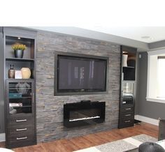 Basement Family Room Design Ideas, gas fireplace with wall mount TV on grey stone feature wall by Kim Hill Family Room Design, House Design, Fireplace Design, Family Room, Basement Family Room, Stone Feature Wall, Contemporary Fireplace, Basement Design, Room Design