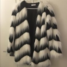 NASTY GAL black and white faux fur coat Super gorgeous and soft in real life. Tagged UK14 approximately US10. I'm a US10 and it's slightly oversized for me. Worn once, as good as new. Retailed online for $198. Nasty Gal Jackets & Coats