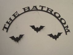 The Batroom Halloween Decorative Wall Sign. $15.00, via Etsy.