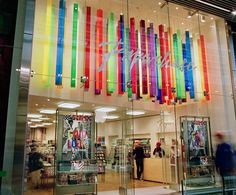 Glass store front with colourful lighting of the Paperchase store in the Westfield Shopping Centre in Stratford.