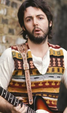 Paul McCartney:) LOL he still looks cute adorable even with his sweater...