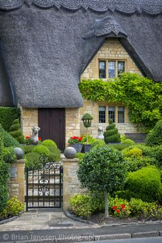 Thatched roof cottage in Chipping-Campden, Gloucestershire, England. © Brian Jannsen Photography Thatched roof cottage in Chipping-Campden, Gloucestershire, England. Garden Cottage, Cottage Homes, Home And Garden, Backyard Cottage, Garden Path, Cottage Porch, Topiary Garden, Cottage Kitchens, English Country Cottages