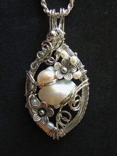 Charmed Silver Pearl Blister Pendant by glsjewelry on Etsy. So lovely!