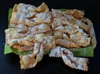 Verwurrelt Gedanken (Deep-fried Carnival Pastry) is a traditional Luxembourgish recipe for a classic snack of a flour, butter, egg milk and sugar dough leavened with bicarbonate of soda and flavoured with lemon zest that's cut into strips and deep fried before serving.