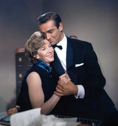 Sean Connery as 'James Bond, 007' and Lois Maxwell as 'Miss Moneypenny'