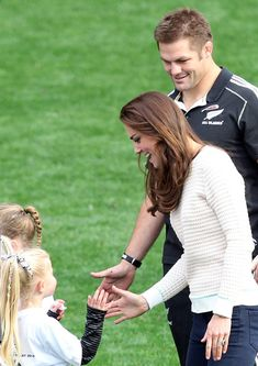 Catherine, Duchess of Cambridge, Prince William, Duke of Cambridge and All Blacks captain Richie McCaw support junior rippa rugby players at Forsyth Barr Stadium, Dunedin on April 13, 2014 in Dunedin, New Zealand