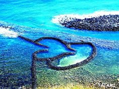 The Double-heart of Stacked Stones (Chinese: 七美雙心石滬; pinyin: Qīměi Shuāng Xīn Shí Hù) or the Twin-Heart Fish Trap is a stone weir located on the north side of Qimei Township, Penghu County, Taiwan. It is a well-preserved ancient fish trap made by stacking stones to form a trap that resembles a flying heart.