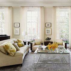 Ecru + Dove Gray + Yellow Soft ecru lends a glowing quality to this living room, while gray is an elegant addition. A restrained use of yellow on the pillows draws out the yellow undertones in the ecru, while adding dimension./