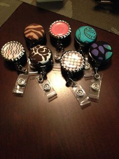 Diy badge retractor reels  Need: fabric, button maker kit ($9.99 at joann fabrics) or vintage bottle caps. The possibilities are endless.