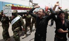Iraqi mourners carry the coffin of Iyad Fadhil al-Surafi