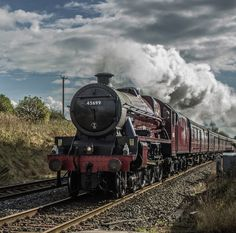 Stanier Jubilee 45699 'Galatea' in fine form storming through Langwathby station with the northbound Hadrian tour on the 11th October 2014.  The tour was originally planned to return south via the Tyne valley line but was rerouted to run both legs via the S&C. This led to an impromptu but worthwhile trip across to Cumbria for the morning!