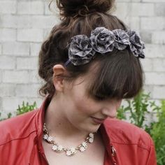Learn how to make fabric rosette flowers and then use them to make this super sweet headband!