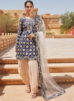 Navy Blue and Golden Beige Embroidered Punjabi Suit features a dhupioni silk kameez with santoon inner, santoon bottom and net dupatta. Embroidery work is completed with zari, thread and stone embellishments on this style. Indian Suits Punjabi, Punjabi Salwar Suits, Punjabi Dress, Salwar Kameez, Indian Wedding Outfits, Pakistani Outfits, Indian Outfits, Wedding Dresses, Designer Bridal Lehenga