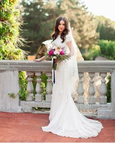 modest wedding dress with lace cap sleeve and a slim fit from alta moda. --(modest bridal gown)--