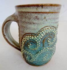 dreamy green mug via etsy. To bring to the library or patio with some nice tea and a book