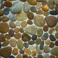 Apply Pebbles or Glass Globs to the Wall - create a design first- cut the tiles to match the size of the backsplash tiles