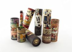 Packaging for licensed Disney products produced by Retro 1951. Cardboard tube design is covered in whimsical vintage Mickey mouse and friend...