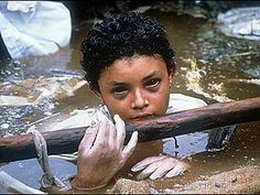 Omayra Sanchez. Frank Fournier photographs 13-year-old Sanchez, victim of a volcanic eruption in Armero, Colombia. 1985.