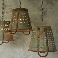 Vintage buckets turned rustic chandeliers. Eloquence Inc.