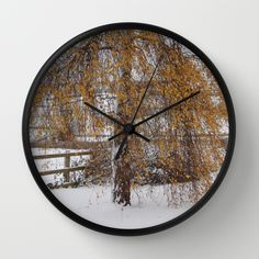 """""""Christmas Is Orange""""  Available in natural wood, black or white frames, $30.00 - our 10"""" diameter unique Wall Clocks feature a high-impact plexiglass crystal face and a backside hook for easy hanging. Choose black or white hands to match your wall clock frame and art design choice. Clock sits 1.75"""" deep and requires 1 AA battery (not included). #clock #tree #landscape #homedecor #christmas #snow"""