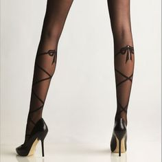 I want these now, please! Tip Toe Lace Up Sheer Tights (via Fab)