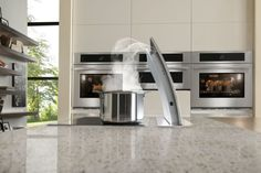 """New Jennair """"Pop Up"""" downdraft ventilation.  Save those water views with the tallest collapsible vent system!"""
