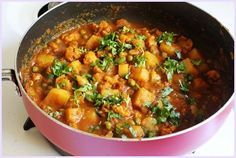 Aloo Gobi Matar – a Punjabi style gravy dish made from potato, cauliflower and green peas with typical North Indian onion-tomato gravy.
