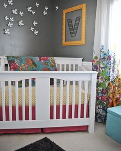 love the framed initial on wall... love the colorful blanket on crib. just love all around.