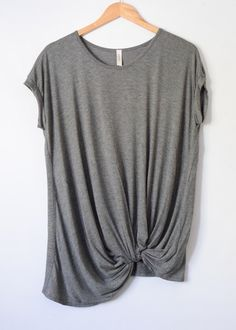 Tay Tee Universal short sleeve tee that looks good on everyone, its the Cinderella shoe of tees. Twist on the basic tee with knotted detail and a breezy look that screams effortless & easy. Make this