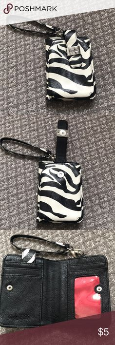 Grace Adele wallet In great condition! It is a smaller wallet that can be carried as a wristlet. It is a cream color and black designed in a zebra print. You can put small items in the front of the wallet where it clips together. Bags Wallets