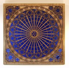 "How freakin' beautiful is this?! -- Inspired by the Gothic architecture of western Europe, this intricate design is created with hand-stained, laser-cut wood layered against richly colored stained glass. Each piece custom made. ""Rose Window in Blue"" by J. Elliott Designs. #gift idea"