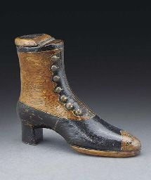 A treen snuff box   In the form of a shoe, with brass strapping and pique decoration applied to the two colour wood, a bone plaque applied to the cover and carved with a depiction of a crowned figure -- 5¾ins.