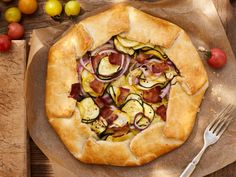 Summer Squash and Bacon Galette : Zucchini and yellow squash go decadent in this cheesy, bacon-studded dish.