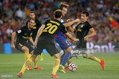 Barcelona's Croatian midfielder Ivan Rakitic vies with Atletico Madrid's…